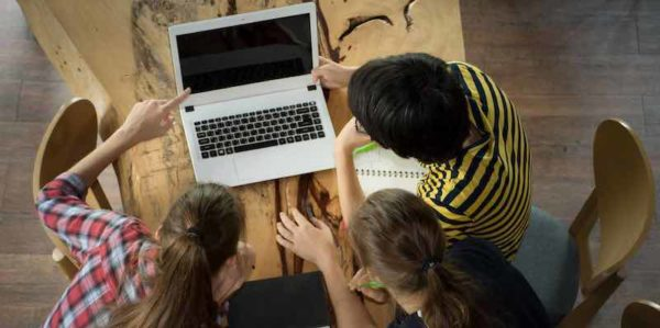 Students focused on computer during small group instruction